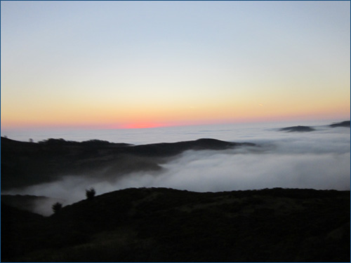 Sunset Over Fog and Mountains